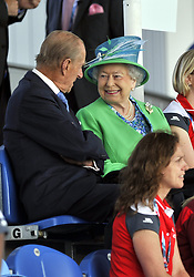 Queen Elizabeth II and the Duke of Edinburgh sit in the stands to watch the England v Wales match at the National Hockey Centre during the 2014 Commonwealth Games in Glasgow. PRESS ASSOCIATION Photo. Picture date: Thursday July 24, 2014. See PA story COMMONWEALTH Hockey. Photo credit should read: John Giles/PA Wire. RESTICTIONS: Editorial use only. No commercial use. No video emulation.