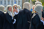 A judges takes a selfie photograph as members of the judiciary walk to the Palace of Westminster following the annual Judges Service which marks the start of the new legal year at Westminster Abbey in London, United Kingdom on 1st October 2019.