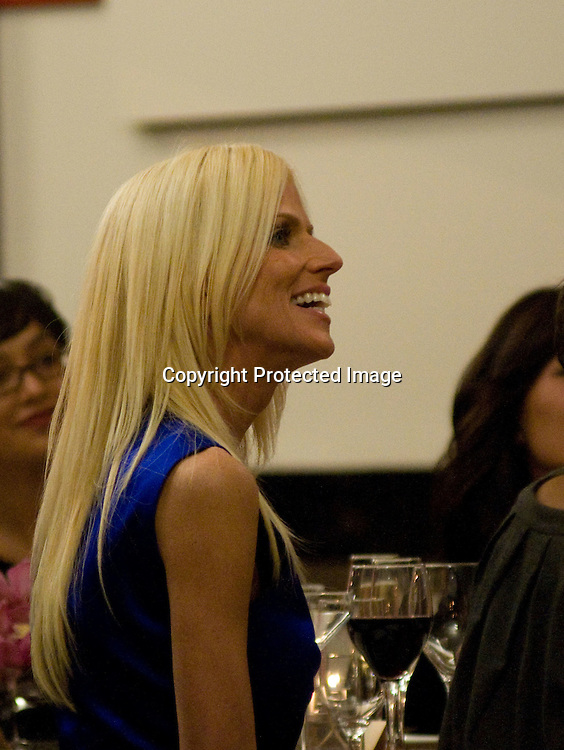 """102209-WashingtonDC- Michaele Salahi of the up and coming Bravo show """"The Real Housewives of DC,"""" listens to the host during a dinner that was being filmed for the show at The Dupont Hotel in Washington DC on October 22, 2009."""