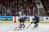 KELOWNA, CANADA - JANUARY 30: Kaedan Korczak #6 of the Kelowna Rockets skates with the puck over centre ice during first period with Brecon Wood #27 of the Seattle Thunderbirds in pursuit  on January 30, 2019 at Prospera Place in Kelowna, British Columbia, Canada.  (Photo by Marissa Baecker/Shoot the Breeze)