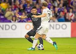 April 21, 2018 - Orlando, FL, U.S. - ORLANDO, FL - APRIL 21: San Jose Earthquakes midfielder Florian Jungwirth (23) clears a ball away from Orlando City forward Dom Dwyer (14) during the MLS soccer match between the Orlando City FC and the San Jose Earthquakes at Orlando City SC on April 21, 2018 at Orlando City Stadium in Orlando, FL. (Photo by Andrew Bershaw/Icon Sportswire) (Credit Image: © Andrew Bershaw/Icon SMI via ZUMA Press)