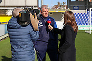 AFC Wimbledon manager Glyn Hodges being interviewed by Sky Sports during the EFL Sky Bet League 1 match between AFC Wimbledon and Fleetwood Town at the Cherry Red Records Stadium, Kingston, England on 8 February 2020.