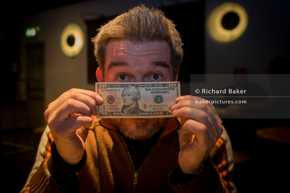 English author, Steve Boggan with the $10 note that he shadowed across America, described in his book 'Follow the Money'.