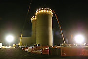 Lights illuminate a 125-foot tall silo Thursday, October 2, 2003, as it is erected in a single pour of concrete by McCormick Construction of Rockford, Minnesota. The process had three crews working 24-hours-a-day for five days to create a silo that can hold 400,000 bushels of corn.