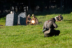 """Re-enactors portraing Soviet soldiers from the Russian 13th Guards Rifle Division """"Poltavaskaya"""" fire a PM M1910 Maxim Machine Gun during a battle reenactment on Day one at the Showground Pickering  <br /> 13 October 2012<br /> Image © Paul David Drabble"""