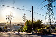October 9, 2019, the sun lowers over the Bay Area through transformer towers and a PG&E electric substation as residents anticipate a pre-emptive power shutoff to help avoid wildfire.