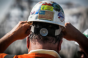 Paul Bitters, Senior Superintendent with Walsh Construction, adjusts his construction helmet while working on the Ohio River Bridge Project.