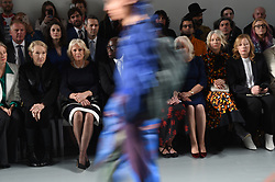 The Duchess of Cornwall (centre left) watches models on the catwalk during a visit to London Fashion Week at the BFC Show Space, London.