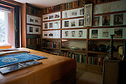 "Items that belonged to T. E. Lawrence, (""Lawrence of Arabia"") are on display, along with pictures and books, inside his bedroom in Clouds Hill, his former home near Wool, Dorset, southwest England."