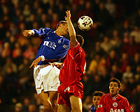 Fotball: Aberdeen v Rangers, Scottish Premier League. Pittodrie. Saturday January 19th.  2002. <br />Flo rises above Philip McGuire for the header.<br /><br />Foto: Ian Stewart, Digitalsport