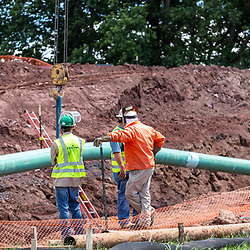 Bachmanville, PA - June 20, 2017: Workers at a construction site to be used in a new energy pipeline in rural Pennsylvania.