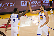 Golden State Warriors forward Andre Iguodala (9) and center JaVale McGee (1) high five during a break from the action against the Indiana Pacers at Oracle Arena in Oakland, Calif., on December 5, 2016. (Stan Olszewski/Special to S.F. Examiner)