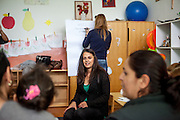 Romina Kajtazova working as a paralegal for NGO Kham -teaching a workshop related to Roma health issues in a kindergarden located in the city of Vinica in Macedonia during  the European Immunization Week. Almost all attending women are from the local Roma community.