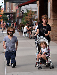 Aug. 27, 2015 - New York City, NY, USA - Actor Peter Dinklage walks in Tribeca with his wife Erica Schmidt and his daughter Zelig on August 27 2015 in New York City  (Credit Image: © Curtis Means/Ace Pictures via ZUMA Press)