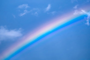 Rainbow on blue sky background