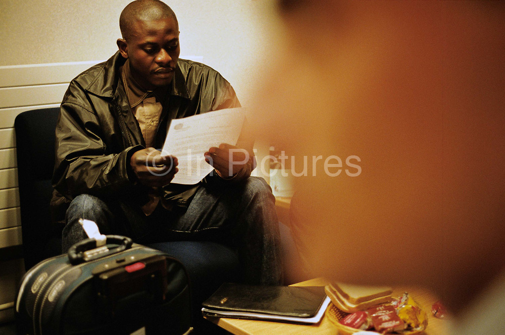A refugee reads a leaflet at the Refugee Arrivals Project at Heathrow Airport He has just claimed political assylum. The Refugee Arrivals Project is a partly government funded charity, that greets and looks after refugees as they arrive in the UK. The RAP is staffed mostly by former refugees from many different nationalities.