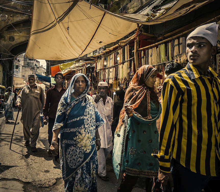 People walking in the old quarter of the city of Ajmer in Rajasthan. The city is well known because it is one of the main pilgrimage places for muslims that come to visit  the shrine of the Sufi Saint Khwaja Moinuddin Chishti.
