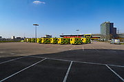 An overview picture looking at the Excel Exhibition Centre in East London, which is now the NHS Nightingale hospital that will deal with coronavirus outbreak patients. In the parking lot, NHS Support Unit personnel is seen deploying its medical support hardware equipment on Saturday morning, March 28, 2020.  NHS Nightingale makeshift hospital is being made into a temporary 4000-bed, comprising of two wards, each of 2,000 people, to help tackle the coronavirus outbreak in Britain. (Photo/Vudi Xhymshiti)