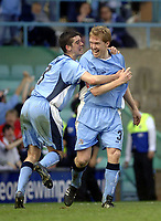 Photo. Glyn Thomas. <br /> Coventry City v Brighton and Hove Albion. <br /> Coca Cola Championship. 02/04/2005.<br /> Coventry's Steve Staunton (R) celebrates scoring his team's second goal with Richard Duffy.