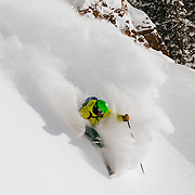 Bryce Newcomb skis blower powder as the sun comes out in-bounds at JHMR.
