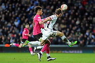 West Brom's Craig Dawson (r) beats Peterborough's Lee Angol to the ball. The Emirates FA Cup, 4th round match, West Bromwich Albion v Peterborough Utd at the Hawthorns stadium in West Bromwich, Midlands on Saturday 30th January 2016. pic by Carl Robertson, Andrew Orchard sports photography.