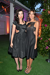 Left to right, DAISY LOWE and ALEXA CHUNG at the Glamour Women of The Year Awards in Association with Next held in Berkeley Square Gardens, Berkeley Square, London on 3rd June 2014.