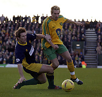 Picture: Henry Browne.<br />Date: 07/02/2004.<br />Wimbledon v Norwich City.<br /><br />Darren Huckerby of Norwich avoids Mark Williams of Dons.