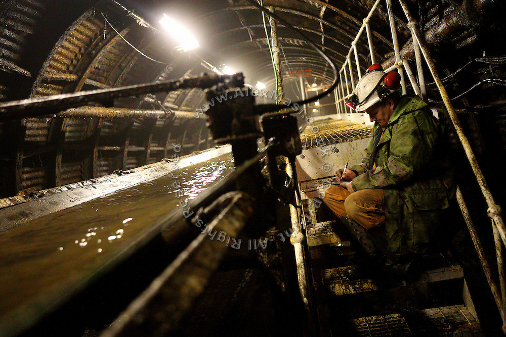 An senior engineer is taking measurements underground at the Unity Mine complex, on Monday, June 18, 2007, in Cwmgwrach, Vale of Neath, South Wales. The time is ripe again for an unexpected revival of the coal industry in the Vale of Neath due to the increasing prize and diminishing reserves of oil and gas, the uncertainties of renewable energy sources, and the technological advancement in producing energy from coal while limiting emissions of pollutants, has created the basis for valuable investment opportunities and a possible alternative to the latest energy crisis. Unity Mine, in particular, has started a pioneering effort to revive the coal industry in the area, reopening after more than 8 years with the intent of exploiting the large resources still buried underground. Coal could be then answer to both, access to cheaper and paradoxically greener energy and a better and safer choice than nuclear energy as a major supply for the decades to come. It is estimated that coal reserves in Wales amount to over 250 million tonnes, or the equivalent of at least 50 years of energy supply, while the worldwide total coal could last for over 200 years as a viable resource compared to only a few decades of oil and natural gas.