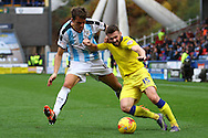 Emyr Huws of Huddersfield Town (l) and Stuart Dallas of Leeds united battle for the ball. Skybet football league Championship match, Huddersfield Town v Leeds United at the John Smith's Stadium in Huddersfield, Yorks on Saturday 7th November 2015.<br /> pic by Chris Stading, Andrew Orchard sports photography.