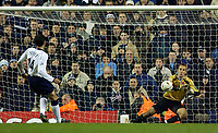 Photo. Jed Wee.<br />Tottenham Hotspur v Middlesbrough, Carling Cup, White Hart Lane, London. 17/12/2003.<br />Spurs' Gustavo Poyet watches his penalty saved by Boro keeper Mark Schwarzer.