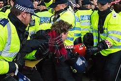 Whitehall, London, May 9th 2015. Scores of protesters are contained by police opposite Downing Street following protests against the Tory election victory.