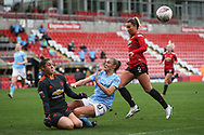 Manchester United goalkeeper Mary Earps (27) saves and collides with Manchester City forward Georgia Stanway (10) during the FA Women's Super League match between Manchester United Women and Manchester City Women at Leigh Sports Village, Leigh, United Kingdom on 14 November 2020.