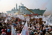 HMS Invincible, British Naval ship seen arriving back in Porstmouth Docks,UK after active duty in the Falklands War. On board the ship were thousands of returning British troops. September 1982. Photograph by Jayne Fincher