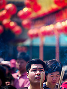 16 FEBRUARY 2018 - BANGKOK, THAILAND: A man prays at Wat Mangkon Kamalawat during Chinese New Year celebrations in the Chinatown neighborhood of Bangkok. Thailand has a large Chinese community and Lunar New Year is widely celebrated, especially in larger cities. This will be the Year of the Dog.      PHOTO BY JACK KURTZ