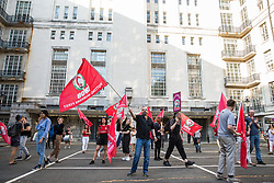 London, UK. 12 July, 2019. Members of the Cleaners and Facilities branch of the IWGB (Independent Workers of Great Britain) trade union, including outsourced workers based at the University of London, protest outside Senate House after failing to arrange a meeting with the university's new Vice-Chancellor Wendy Thomson. Credit: Mark Kerrison/Alamy Live News