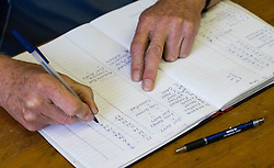 © Licensed to London News Pictures.04/08/15<br /> Egton, UK. <br /> <br /> <br /> The various weights of gooseberries are entered into a log book during the annual Egton Gooseberry Show. <br /> There are only two Gooseberry societies left in the country. One in Cheshire and one at Egton in North Yorkshire. The annual show in Egton uses traditional Avoridupois scales to measure the weight of the berries and members of the society are fanatical about trying to grow the best berries each year. <br /> <br /> Photo credit : Ian Forsyth/LNP