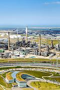 Nederland, Zuid-Holland, Rotterdam, 10-06-2015. Suurhoffbrug over het Hartelkanaal. Hoofdkantoor van BP in de oksel van de weg. OP het tweede plan de Europoort raffinaderij van BP.<br /> Hartel canal in Europoort, Suurhoff  bridge, main office BP and refinery.<br /> luchtfoto (toeslag op standard tarieven);<br /> aerial photo (additional fee required);<br /> copyright foto/photo Siebe Swart