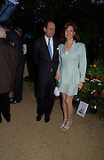 Mr. and Mrs. Nicholas Mavroleon. Cartier dinner after thecharity preview of the Chelsea Flower show. Chelsea Physic Garden. 23 May 2005. ONE TIME USE ONLY - DO NOT ARCHIVE  © Copyright Photograph by Dafydd Jones 66 Stockwell Park Rd. London SW9 0DA Tel 020 7733 0108 www.dafjones.com
