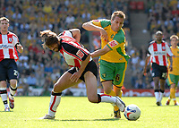 Photo: Ashley Pickering.<br /> Norwich City v Southampton. Coca Cola Championship. 28/04/2007.<br /> Darren Huckerby of Norwich (R) rides a tackle from Alexander Ostlund of Southampton
