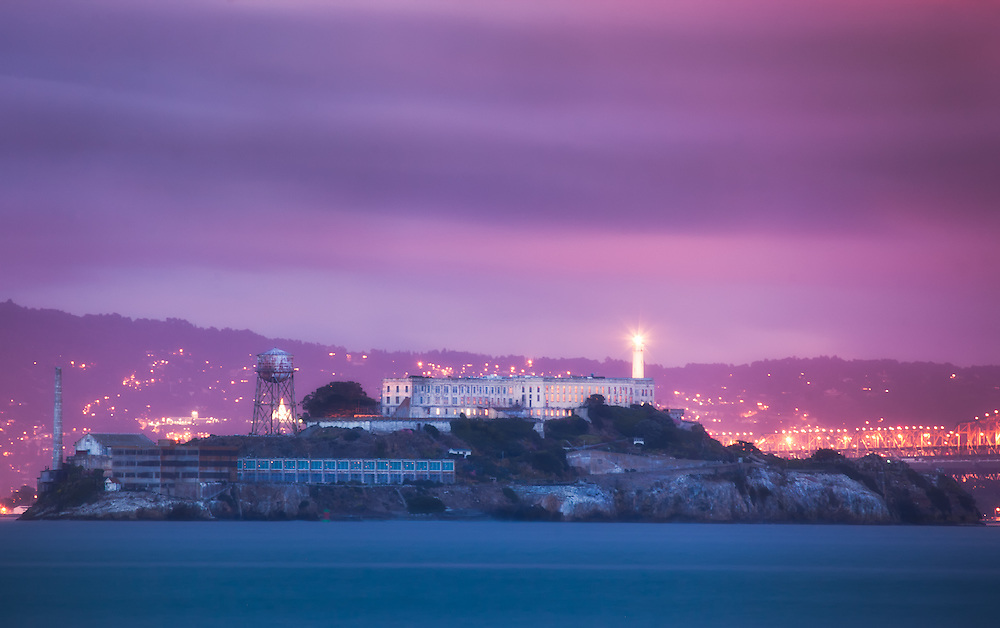 night time glowing lights of Alcatraz prison in san francisco bay ( the rock)  at sunset, the blue hour