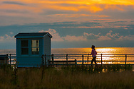 Spring Lake, NJ USA -- September 7, 2017 A woman walking on the Spring Lake boardwalk in the early morning hours. Editorial Use Only.