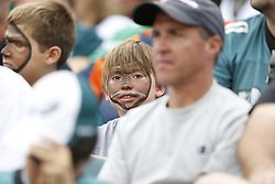 A young football fan in the stands with his face painted like a football during the NFL football game between the Baltimore Ravens and the Philadelphia Eagles in Philadelphia on Sunday, September 16th 2012. The Eagles won 24-23. (Photo By Brian Garfinkel)