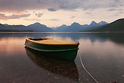 A boat waits on the shore of McDonald Lake in Glacier National Park. Missoula Photographer, Missoula Photographers, Montana Pictures, Montana Photos, Photos of Montana
