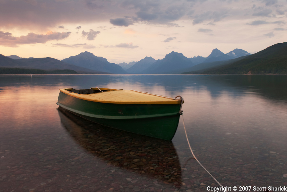 A boat waits on the shore of McDonald Lake in Glacier National Park. Missoula Photographer, Missoula Photographers, Montana Pictures, Montana Photos, Photos of Montana