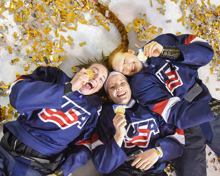DMITROV, RUSSIA - JANUARY 13:  USA's Taylor Heise #23, Britta Curl #14 and Dominique Petrie #11 showing off their gold medals following a 9-3 gold medal game win against Sweden at the 2018 IIHF Ice Hockey U18 Women's World Championship. (Photo by Steve Kingsman/HHOF-IIHF Images)