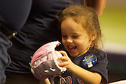 MLB: SEP 12 Red Sox at Rays. A little girls first game, the Red Sox Fan is delighted as she gets given a ball from one of the players. during the MLB game between the Boston Red Sox and the Tampa Bay Rays.<br /> <br /> At Tropicana Field, Tampa, FL.