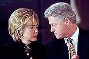 President Bill Clinton sits with first lady Hillary during a child care event at the White House February 23, 1999 in Washington, DC.