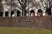 Residents enjoy the sunshine in the Hofgarten, in central Munich, on a beautiful early winter's day