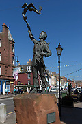 The statue by Ukranian artist Valentin Znoba, of the Scots-born American environmentalist, John Muir in Dunbar High Street, on 27th June 2019, in Dunbar, East Lothian, Scotland. John Muir 1838–1914 also known as John of the Mountains and Father of the National Parks was an influential Scottish-American naturalist, author, environmental philosopher, glaciologist, and early advocate for the preservation of wilderness in the United States of America but spent his childhood in Dunbar until emigrating to America at the age of 11.