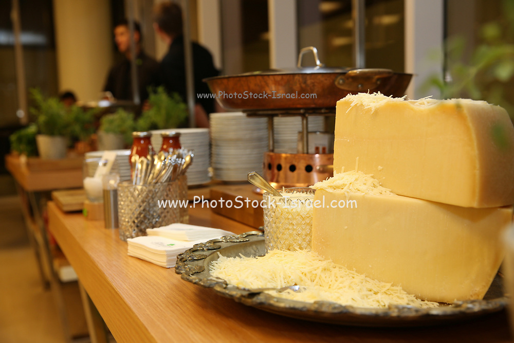 Yellow cheese wheels and gratings